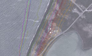 This tank farm (center) has already been relocated. The yellow line shows the projected shoreline in 2035, by which time Port Heiden's Goldfish Lake (at right) will likely be a part of the Bay.