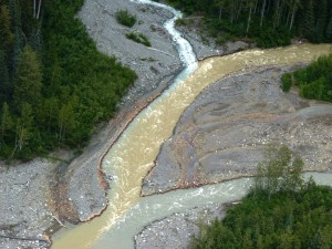 Sulphurets Creek, which drains naturally occurring rusty water from the KSM prospect, enters the Unuk River. (Photo by Ed Schoenfeld/CoastAlaska News)