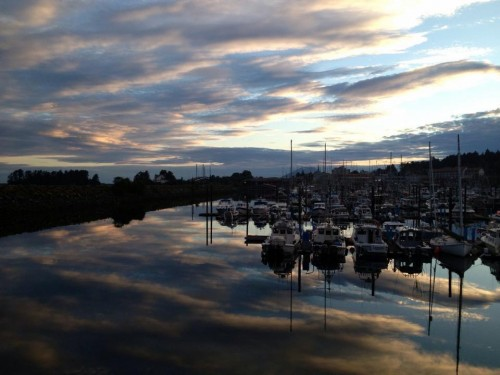 A summer sunset colors the waters of Sitka's Crescent Harbor in 2014. Municipal officials want to improve three harbors using a state grant program that may be at risk. (Shaleece Haas/KCAW)
