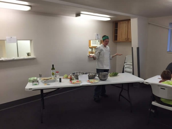(Chef Danielle Flaherty prepares some brussel sprouts at a recent cooking demonstration at the Galena Pool)
