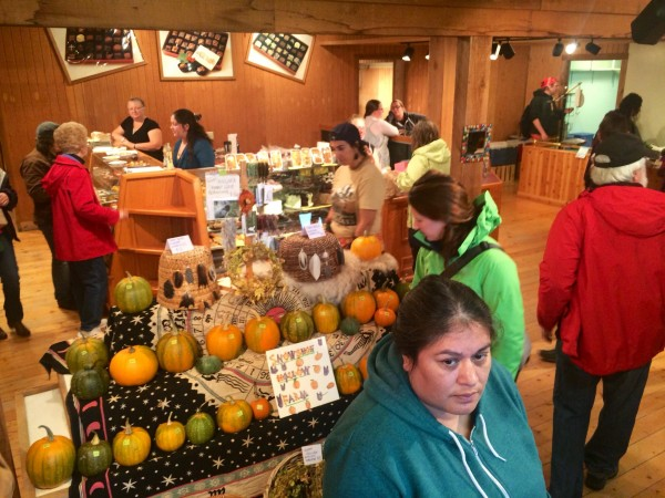 Shoppers inside Homer's first indoor farmers' market. (Photo by Daysha Eaton/KBBI)