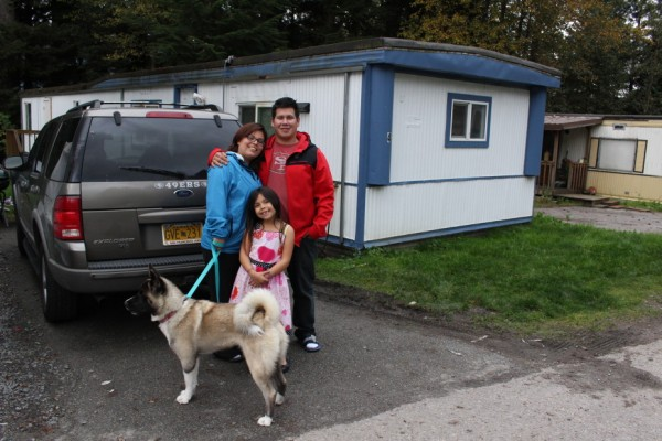 James Refuerzo and his family outside their home. (Photo by Elizabeth Jenkins/KTOO)