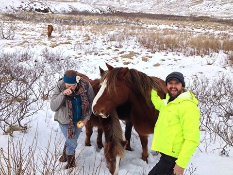 Keith Davis and a friend with Unalaska Island's wild horses in 2013. Courtesy Lynn Goodman.