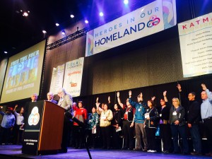 Raising an hand signing the number four became a symbol of solidarity at the 2015 AFN convention. Photo: Daysha Eaton/KBBI.