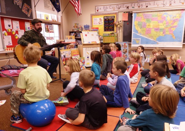 Music teacher James Baldwin sings with first and second graders. (Emily Files/KHNS)
