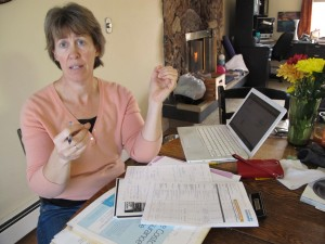 Victoria Cronquist shops for lower cost health insurance at her Anchorage home. She may drop coverage.