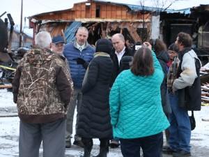 Gov. Bill Walker visiting the Kilbuck fire site along with LKSD Superintendent Dan Walker and Rep. Bob Herron. (Photo by Dean Swope/KYUK)