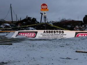 Asbestos warnings surrounding the KIlbuck campus. (Photo by Dean Swope/KYUK)
