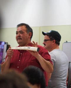 Middy Johnson shows off a walrus tusk etched by Gary Sockpick of Shishmaref. Photo: Zachariah Hughes, KSKA.
