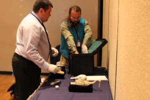 Eric Hollinger and Robert Starbard put away the replicas. Photography can be a sensitive subject when it comes to shamanic objects. These were photographed with permission. (Photo by Elizabeth Jenkins/KTOO)