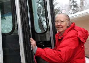 Vivian Cole boards the bus outside of the Daybreak center. (Hillman/KSKA)