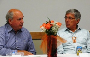 British Columbia Mines Minister Bill Bennett, left, and Alaska Lt. Gov. Byron Mallott talk at a dinner at Juneau's Walter Soboleff Center in August. (Photo courtesy of the governor's office)