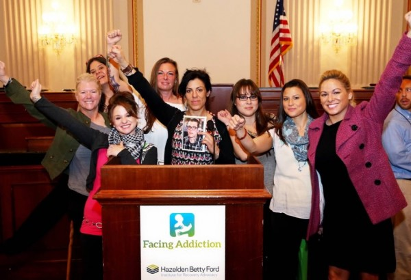 Alaskans were part of the UNITE to Face Addiction Rally in Washington, D.C.: (left to right) Kim Whitaker, Julee Douglas, Samantha Garton, Terria Walters, Kara Nelson, Delia Williams, Jennifer Mcallister and Christina Love inside a congressional office building in D.C. in October. Nelson is holding a picture of Christopher Seaman, the son of Walters who was murdered in Mat-Su in June. (Photo courtesy Kara Nelson)