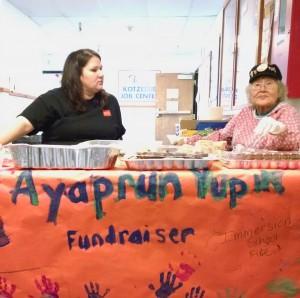 Jennifer Howarth (left) and Ida Aanataiyaaq Biesemeier (right) at the Kotzebue bake sale, raising money for Bethel's Ayaprun school. (Photo by Molly Sheldon)