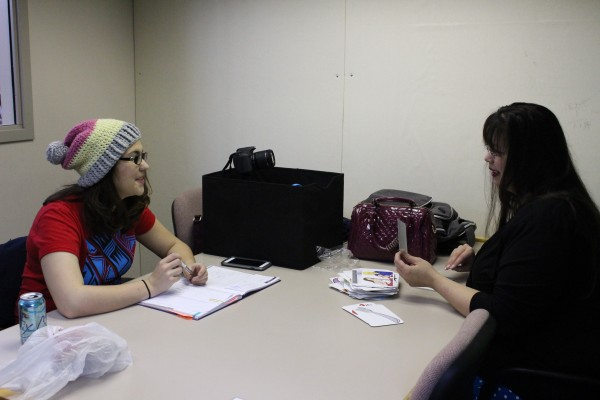 Emily Rose Edenshaw-Chafin and Susie Lee Edwardson plan out their next YouTube video. (Photo by Elizabeth Jenkins/KTOO)