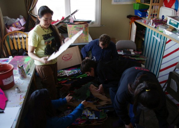Anna Rae Petla, employee Gregg Marxmiller, and other teens organize the art room at Myspace. CREDIT MOLLY DISCHNER/KDLG