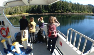 Passengers enjoy the scenery during a Sept. 3, 2015, fast ferry Chenega sailing between Sitka and Juneau. Sitka would lose most of its ferry service under a schedule based on a reduced budget proposed by Gov. Bill Walker. (Photo by Ed Schoenfeld/CoastAlaska News)
