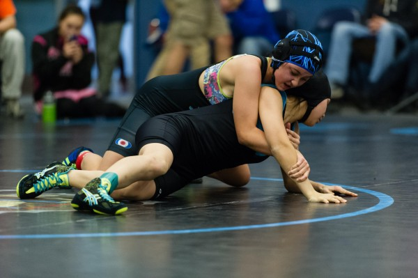Dillingham's Cate Gomez with an upper hand on Johanna Bell from Scammon Bay. Gomez placed second at regionals, but found out Sunday night she'll get to go to state next weekend too. CREDIT KEVIN TENNYSON. Shared via KDLG.org.