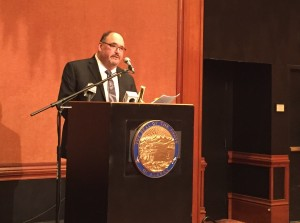 Commission Chair Greg Razo talks about the new report at the Captain Cook Hotel. (Hillman/KSKA)