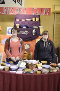 Phoenix Williams and Brianna Frisby help run the Juneau-Douglas High School art club booth at Public Market, which was located in the Juneau Arts & Culture Center. (Photo by Peter Metcalfe)