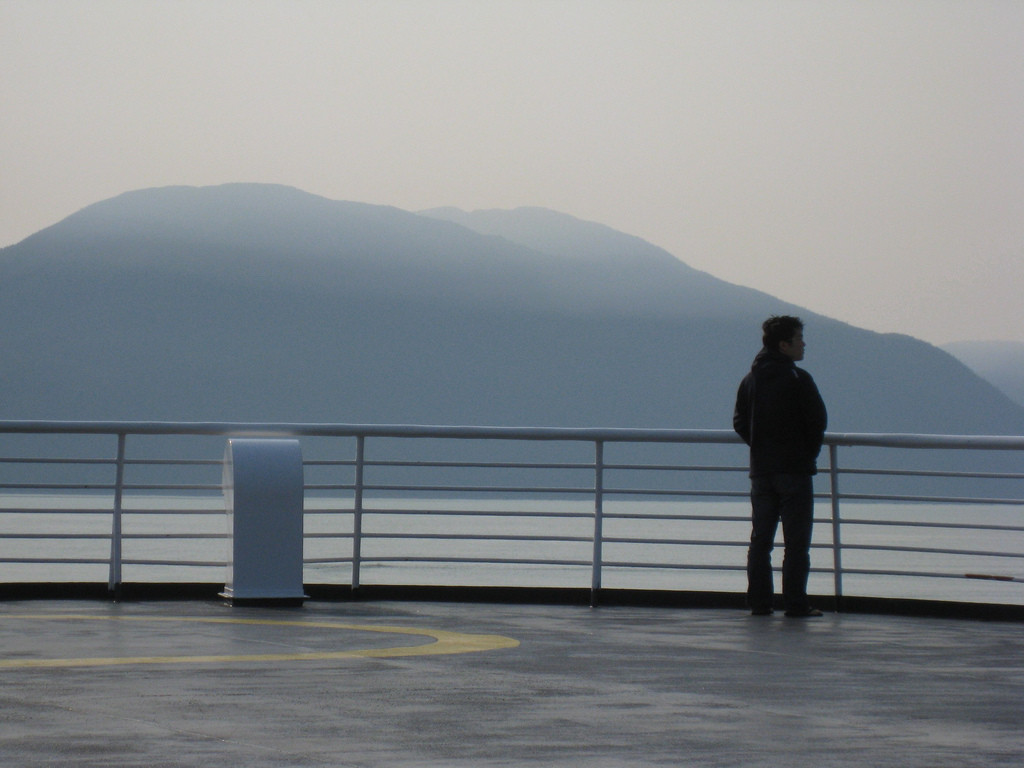 A passenger on the deck of an Alaska Marine Highway ferry. (Flickr Creative Commons – supafly)