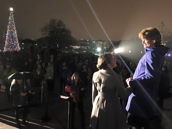 Sen. Lisa Murkowski and Alaska student Anna DeVolld hold hands after the lighting of the Capitol Christmas. Photo: Sen. Lisa Murkowski's Facebook page.