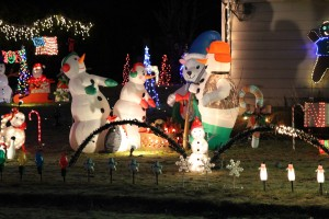 Snowmen warming up by the fire in the Romine's yard. (Brielle Schaeffer/KCAW photo)