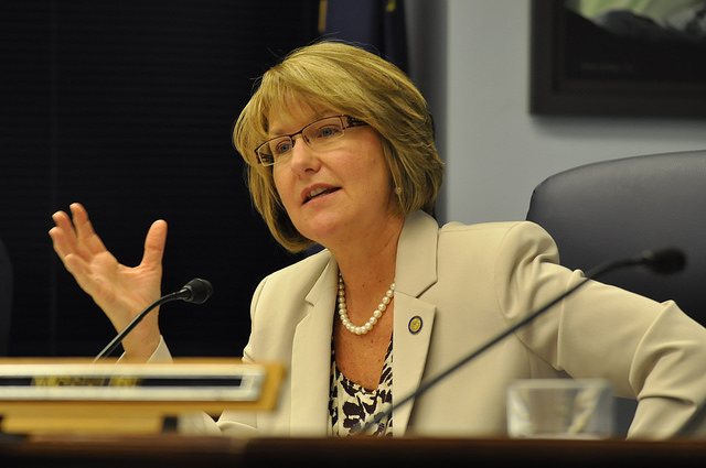 Sen. Anna MacKinnon participates in a discussion during a Senate Resources Committee meeting, Feb. 5, 2014. (Photo by Skip Gray/Gavel Alaska)