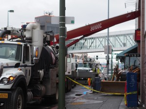 ML&P crews work on digging through cement to reach a malfunctioning transformer knocked out during the earthquake, interrupting power to the 5th Avenue Mall. Photo: Zachariah Hughes.