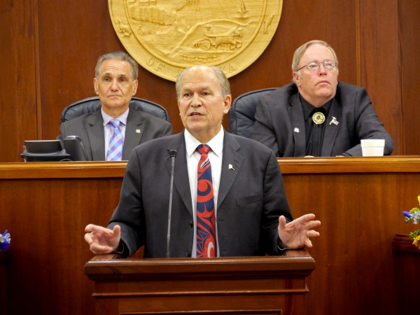 Alaska Gov. Bill Walker delivers his annual State of the State Address to the legislature, Jan. 21, 2016. Behind him (left to right) are Senate President Kevin Meyer and Speaker of the House Mike Chenault. (Photo by Skip Gray/360 North)