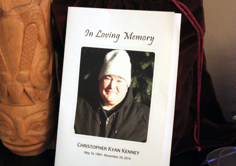 Chris Kenney's ashes sit next to one of his wood carvings on a table stand in his brother Rob Kenney's house. (Photo by Lisa Phu, KTOO)