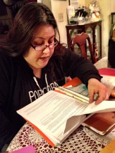 Angela LaRose scours documents related to the death of her sister. (Photo: Liz Ruskin)