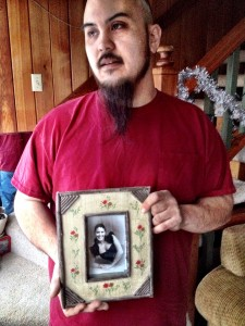 Randy LaRose holds a picture of his sister, Michelle Clark, an Alaska National Guard sergeant who died in 2011.