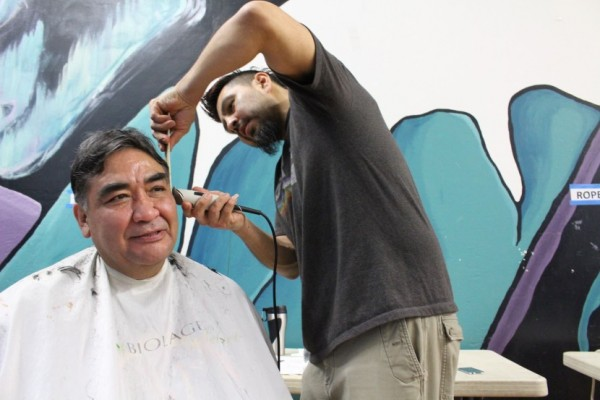 John Ross gets his hair cut by Marti Fred at Shear Design. (Photo by Elizabeth Jenkins/KTOO)