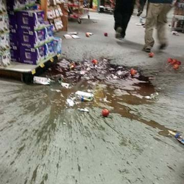 Clerks at Save U More found some cleanup waiting for them after Sunday morning's quake. (Photo by Michael Rohrbacher )