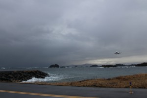 Sitka's runway is encompassed by the Pacific Ocean. The tides bring in debris and some of that debris attracts birds, creating a natural buffet (Emily Kwong/KCAW photo)