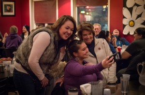 Senator Lisa Murkowski posing for a selfie with locals Naomi Jorgensen and Vanessa Connors at Nome's Airport Pizza. (Photo: Mitch Borden/KNOM)
