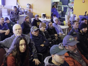 Mushers, handlers and organizers attend the Kuskokwim 300 Musher's Hall meeting Jan 14. (Photo by Chris Pike/ KYUK)