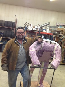 Garley with an in-progress Joe Redington statue. Photo: Ellen Lockyer, KSKA-Anchorage