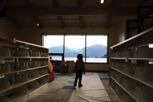 Shewa Bryner roams the shelves and tries out the view. (Emily Kwong/KCAW photo)