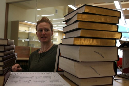 Librarian Brooke Schafer begins unpacking reference books. (Emily Kwong/KCAW photo)