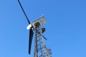 Mike Wassallie climbs a wind turbine in Kwigillingok. Photo: Rachel Waldholz/APRN