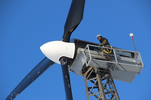 Mike Wassallie climbs a wind turbine in Kwigillingok to check the blades after a blizzard. Photo: Rachel Waldholz/APRN