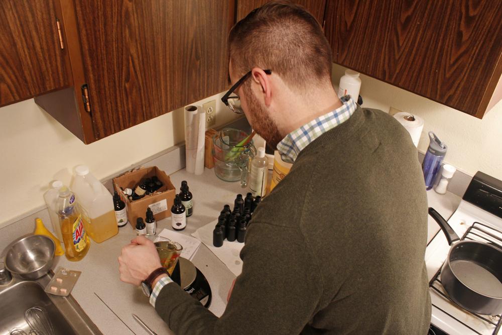 Kyle Reading prepares a batch of Flintlock beard oil. (Photo by Josh Edge/APRN)