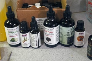 """Essential oils and scents you can find in the Cut & Caliber """"vault."""" (Photo by Josh Edge/APRN)"""