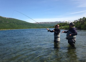 David Parks Jr. gives some casting tips to his client Sarah Pearl in the Kulik River at the Bristol Bay Guide Academy, June 2015. (Photo by Matt Martin/KDLG)