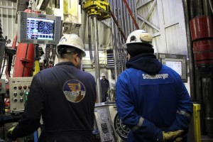 Two contractors monitor the drilling of an injection well at ConocoPhillips' CD5 drill site on the North Slope. Photo: Rachel Waldholz/APRN