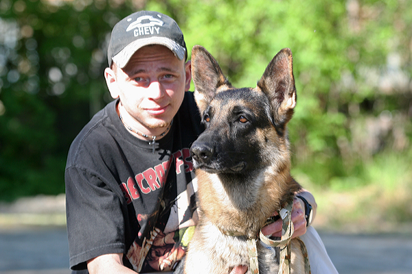 "Buddy the ""hero dog"" and his owner Ben Heinrichs in 2010 (Photo by Diana Haecker, KTNA - Talkeetna.)"