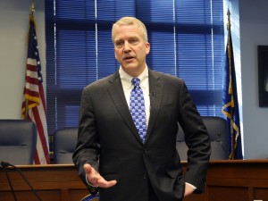 U.S. Sen. Dan Sullivan talks to reporters after his annual address to the Alaska Legislature. (Skip Gray/360 North)