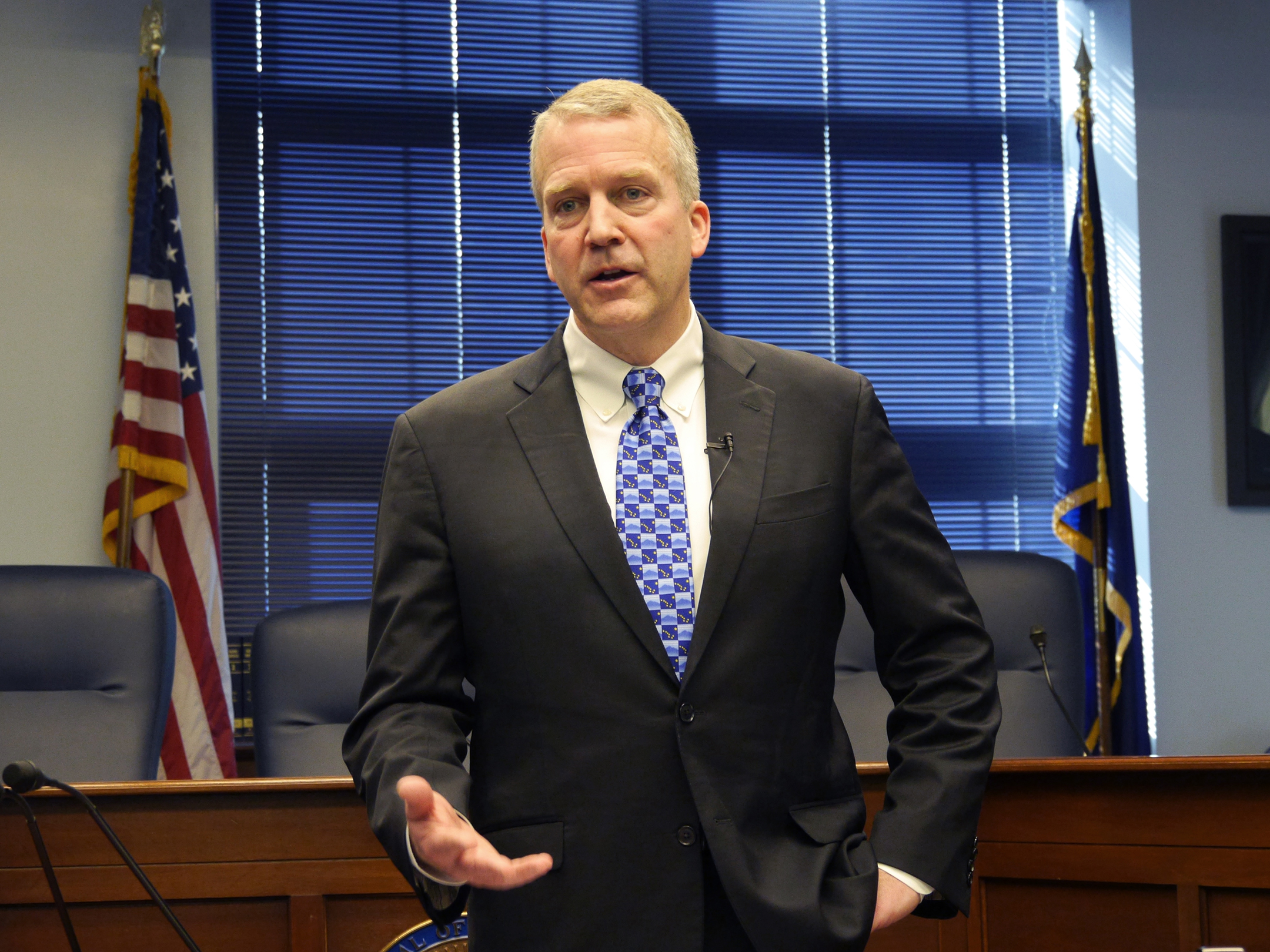 U.S. Sen. Dan Sullivan talks to reporters after his annual address to the Alaska Legislature. (File photo by Skip Gray/360 North)